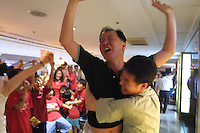 South Koreans celebrate their national team's upset victory over Spain in a quarterfinal match of the FIFA  2002 World Cup in a shopping center in Seoul, South Korea.