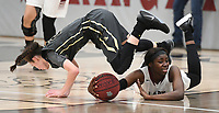 NWA Democrat-Gazette/J.T. WAMPLER Bentonville's Fess Hawkins makes a play for the basket under pressure from Ashlyn Minchew and  Springdale's Marquesha Davis scramble for a loose ball Tuesday Feb. 13, 2018 at Bulldog Arena. Springdale lost 35-34 in overtime.