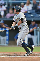 Charleston RiverDogs right fielder Michael O'Neill #10 swings at a pitch during a game against the Asheville Tourists at McCormick Field July 29, 2014 in Asheville, North Carolina. The RiverDogs defeated the Tourists 9-3. (Tony Farlow/Four Seam Images)