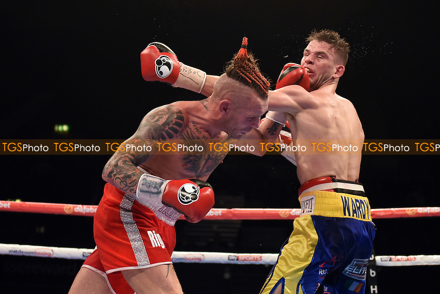 Martin J Ward (blue/yellow shorts) defeats Ronnie Clark to win the British Super-Featherweight Title during a Boxing Show at the SSE Arena, Wembley on 26th November 2016