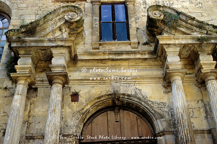 Decaying facade of the White Penitent Chapel in Sarlat-la-Caneda, Dordogne, France.