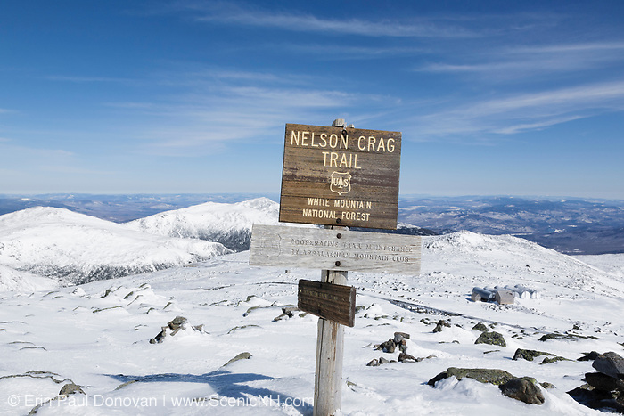 Nelson Crag Trail sign on the summit of Mount Washington in the White Mountains, New Hampshire during the winter months. Mount Washington, at 6,288 feet, is the tallest mountain in the northeastern United States.