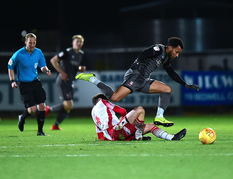 Lincoln City's Matt Green vies for possession with  Stevenage's Michael Timlin<br /> <br /> Photographer Andrew Vaughan/CameraSport<br /> <br /> The EFL Sky Bet League Two - Stevenage v Lincoln City - Saturday 8th December 2018 - The Lamex Stadium - Stevenage<br /> <br /> World Copyright © 2018 CameraSport. All rights reserved. 43 Linden Ave. Countesthorpe. Leicester. England. LE8 5PG - Tel: +44 (0) 116 277 4147 - admin@camerasport.com - www.camerasport.com