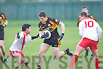 Austin Stacks Joe O'Kelly tries to get passed An Ghaeltacht's Martin Ó Garmáin and Colm Ó Beaglaoich at Connolly park, Tralee on Saturday.