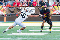 College Park, MD - SEPT 23, 2017: Maryland Terrapins running back Lorenzo Harrison III (2) breaks free from a tackle of UCF Knights linebacker Pat Jasinski (56) during game between Maryland and UCF at Capital One Field at Maryland Stadium in College Park, MD. (Photo by Phil Peters/Media Images International)