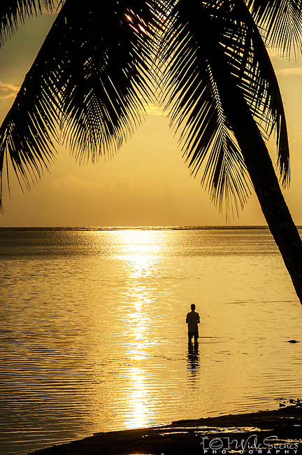 Local fishing at sunset on the coral coast on Viti Levu, Fiji