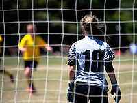 Action from the New Zealand Age Group Championships Under-16 Girls match between Capital (yellow tops) and Mainland at Memorial Park in Petone, Wellington, New Zealand on Sunday, 17 December 2017. Photo: Dave Lintott / lintottphoto.co.nz