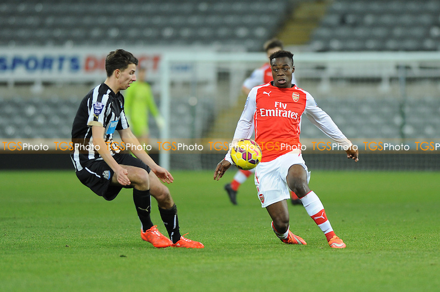 Alex Inobi of Arsenal battles with Dan Barlaser of Newcastle United - Newcastle United Under-21 vs Arsenal Under-21 - Barclays Under-21 Premier League Football at St James Park, Newcastle United FC - 09/02/15 - MANDATORY CREDIT: Steven White/TGSPHOTO - Self billing applies where appropriate - contact@tgsphoto.co.uk - NO UNPAID USE