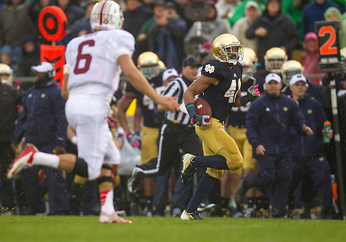 October 13, 2012:  Notre Dame safety Matthias Farley (41) returns interception for yardage during NCAA Football game action between the Notre Dame Fighting Irish and the Stanford Cardinal at Notre Dame Stadium in South Bend, Indiana.  Notre Dame defeated Stanford 20-13.