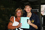 Daniel Kennedy with fan Stanley Johns who gave him a new watch in a Tiffany bag on the AMC Bus Trip Around Manhattan held on September 12, 2009 from the upper east side to Battery Park, Ground Zero and all around Manhattan. (Photo by Sue Coflin/Max Photos)