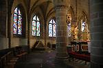 FRANCE - Interior of French church in Normandy.<br /> Glas in lood ramen en oude houten banken historische kerken in Normandie, die jaarlijks vele toeristen trekken. COPYRIGHT TON BORSBOOM