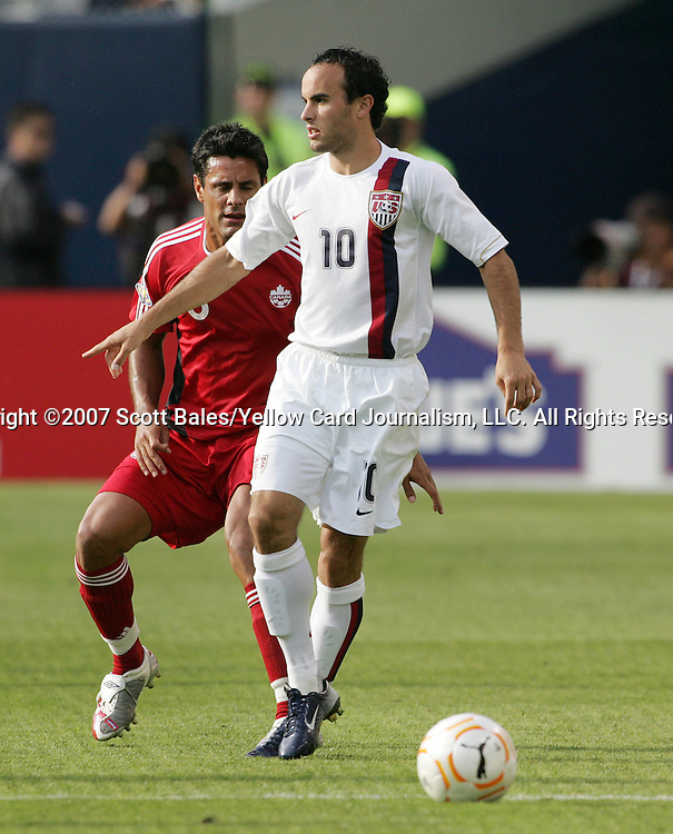 21 June 2007:  United States midfielder Landon Donovan (10) is guarded by Canada's Ante Jazic (left). The United States Men's National Team defeated the national team of Canada 2-1 in a CONCACAF Gold Cup Semifinal match at Soldier Field in Chicago, Illinois.