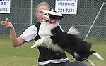 05/05/05....Gary Wilcox/staff......Lara Goldberg and Louie in a frisbee demo at the opening of Paws Park at Wingate Park in Jacksonville Beach. Lara Goldberg and Louie are members of the Greater Jacksonville disc & dog club in Jacksonville.