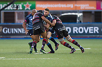Aled Summerhill of Cardiff Blues is tackled by Darryl Marfo and Anton Bresler of Edinburgh during the Guinness PRO14 match between Cardiff Blues and Edinburgh Rugby at BT Sport Cardiff Arms Park, Cardiff, Wales on 1 September 2017. Photo by Mark  Hawkins.