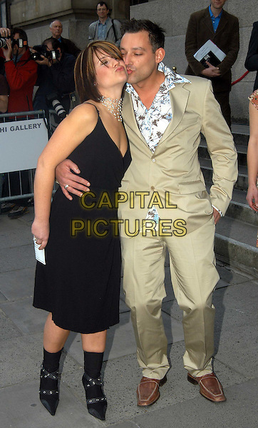 HARRIET SCOTT & TOBY ANSTIS.Launch of the Saatchi Gallery's new home at County Hall.www.capitalpictures.com.sales@capitalpictures.com.©Capital Pictures.kissing, posing
