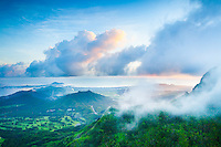 Misty clouds touch the top of Nu'uanu Pali, with Kailua in the distance, O'ahu.