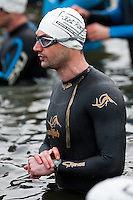 09 MAY 2010 - GRENDON, GBR - A competitor prepares to start his stopwatch as his wave gets underway at the Grendon Triathlon .(PHOTO (C) NIGEL FARROW)