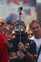 Mar 29, 2014; Las Vegas, NV, USA; An NHRA fan in the nitro pits with a GoPro camera on a stick during qualifying for the Summitracing.com Nationals at The Strip at Las Vegas Motor Speedway. Mandatory Credit: Mark J. Rebilas-