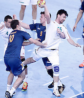 Australia's Caleb Gahan (l) and Tommy Fletcher (c) and Hungary's Mate Lekai (r) during 23rd Men's Handball World Championship preliminary round match.January 14,2013. (ALTERPHOTOS/Acero) /NortePhoto