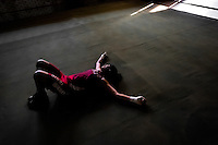 Geraldin Hamann, a young Colombian boxer, is seen during a muscular strength exercise in the boxing gym in Cali, Colombia, 27 June 2013. During the recent years, Kina Malpartida, a Peruvian female professional boxer, has won the World Championship title several times and so she has become a sporting idol and an inspiration for a generation of young girls throughout Latin America. Working out hard in poorly equipped gyms, they dream of becoming a boxing star. The Cauca Valley and the Caribbean coast are believed to be a home of the most talented female boxers in Colombia.