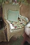 A Lloyd loom chair with a cushion