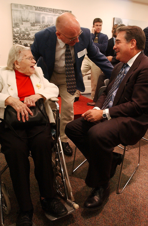 drugs2/062603 - Rep. Billy Tauzin, R-La., talks with Mattie Wimer, 83, and Jim Downey, 65, both of W.V., and during rally for prescription drugs, Thursday.