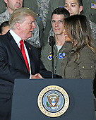 United States President Donald J. Trump shakes hands with first lady Melania Trump prior to delivering remarks to military personnel and families in a hanger at Joint Base Andrews in Maryland on Friday, September 15, 2017.  He visited JBA to commemorate the 70th anniversary of the US Air Force.<br /> Credit: Ron Sachs / CNP