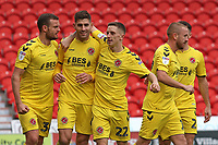 Fleetwood Town's Ched Evans (9) is mobbed after scoring his side's first goal<br /> Photographer David Shipman/CameraSport<br /> <br /> The EFL Sky Bet League One - Doncaster Rovers v Fleetwood Town - Saturday 6th October 2018 - Keepmoat Stadium - Doncaster<br /> <br /> World Copyright &copy; 2018 CameraSport. All rights reserved. 43 Linden Ave. Countesthorpe. Leicester. England. LE8 5PG - Tel: +44 (0) 116 277 4147 - admin@camerasport.com - www.camerasport.com