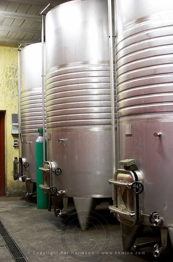 Domaine Jean Baptiste Senat. In Trausse. Minervois. Languedoc. Stainless steel fermentation and storage tanks. Floating top vats. Cooling coils for temperature control. France. Europe.