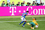 26 June 2006: Row of photographers with long lenses stop to watch the close-up action as Mile Sterjovski (AUS) (21) stumbles and Fabio Grosso (ITA) (3) looks to take advantage. Italy (1st place in Group E) defeated Australia (2nd place in Group F) 1-0 at Fritz-Walter Stadion in Kaiserslautern, Germany in match 53, a Round of 16 game, in the 2006 FIFA World Cup.