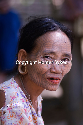PANMYAUNG VILLAGE,  Myanmar (Burma) 2008.Chin tribal women with tattooed faces.