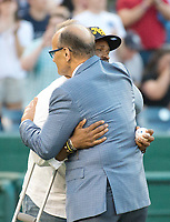 United States Capitol Police Officer David Bailey, who was wounded in yesterday's attack in Virginia hugs former New York Yankee manager Joe Torre prior to the 56th Annual Congressional Baseball Game for Charity where the Democrats play the Republicans in a friendly game of baseball at Nationals Park in Washington, DC on Thursday, June 15, 2017. Photo Credit: Ron Sachs/CNP/AdMedia