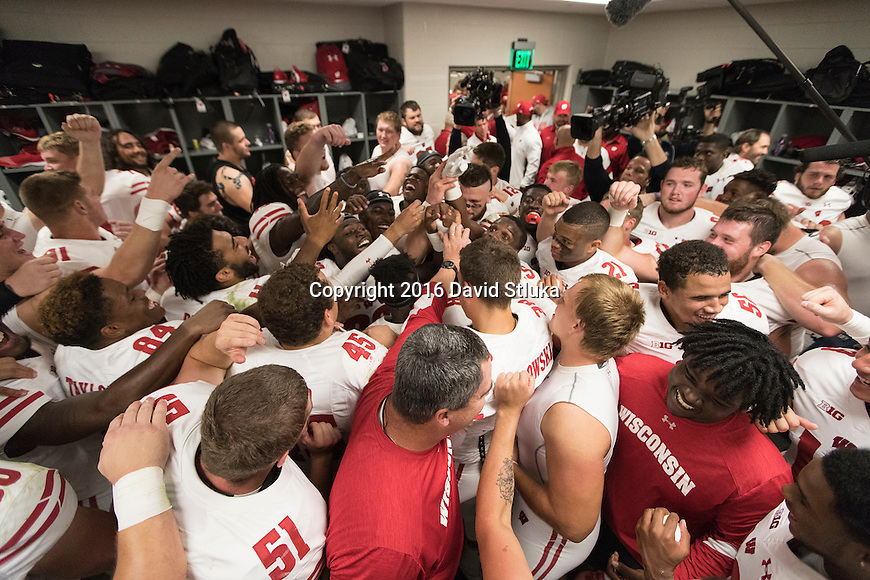 Wisconsin Badgers teammates celebrate in the locker room after an NCAA college football game against the Michigan State Spartans Saturday, September 24, 2016, in East Lansing, Michigan. The Badgers won 30-6. (Photo by David Stluka)