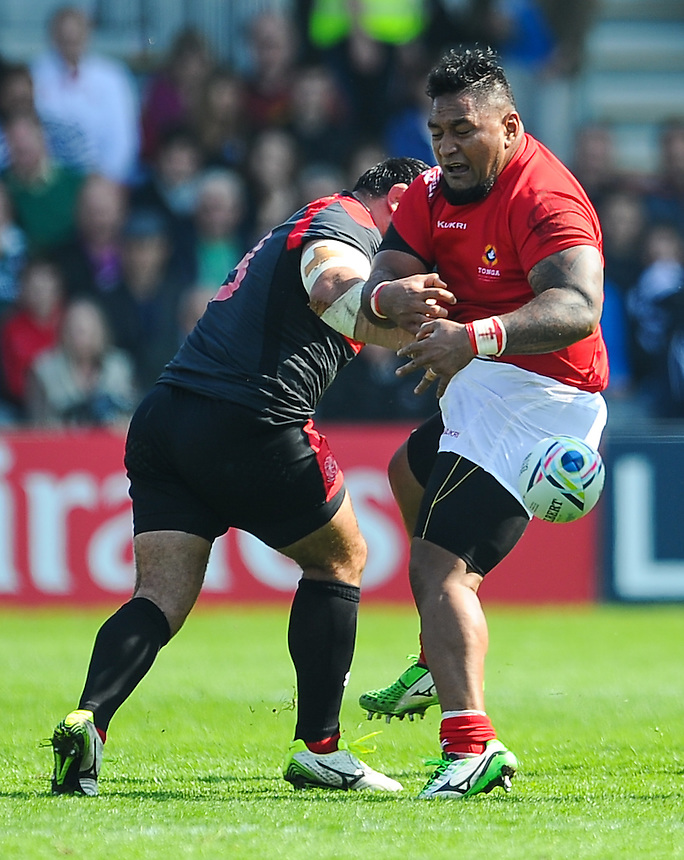 Tonga's Tevita Mailau has the ball dislodged by the tackle of Georgia's Davit Zirakashvili<br /> <br /> Photographer Craig Thomas/CameraSport<br /> <br /> Rugby Union - 2015 Rugby World Cup - 12;00  Georgia v Tonga - Saturday 19th September 2015 - Kingsholm - Gloucester <br /> <br /> &copy; CameraSport - 43 Linden Ave. Countesthorpe. Leicester. England. LE8 5PG - Tel: +44 (0) 116 277 4147 - admin@camerasport.com - www.camerasport.com