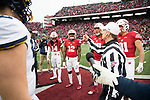 Wisconsin Badgers captains D'Cota Dixon (14), from left to right, Natrell Jamerson (12), Alec James (57) and Troy Fumagalli (81) watch the coin toss during an NCAA College Big Ten Conference football game against the Michigan Wolverines Saturday, November 18, 2017, in Madison, Wis. The Badgers won 24-10. (Photo by David Stluka)
