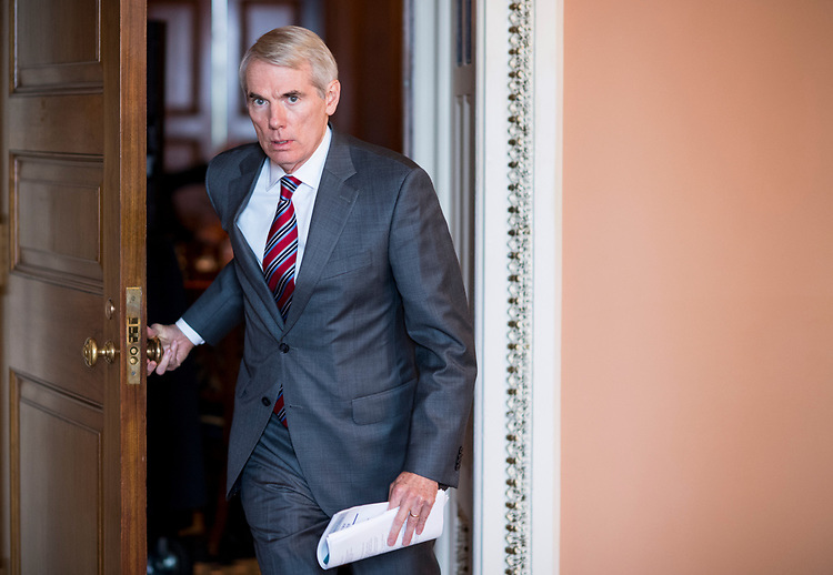 UNITED STATES - JUNE 26: Sen. Rob Portman, R-Ohio,  leaves the Senate Republicans' policy lunch in the Capitol on Tuesday, June 26, 2018. (Photo By Bill Clark/CQ Roll Call)
