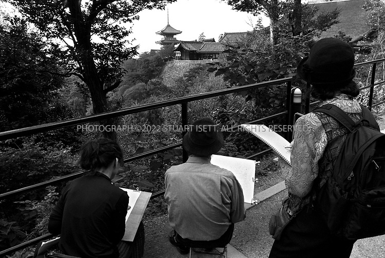 March, 2003--Kyoto, Japan..Japanese tourists paint the perfect view of Kiyomizu Temple...All photographs ©2003 Stuart Isett.All rights reserved.This image may not be reproduced without expressed written permission from Stuart Isett.