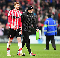 Lincoln City's Cian Bolger, left, and Lincoln City's first team goalkeeping coach Andy Warrington at the end of the game<br /> <br /> Photographer Andrew Vaughan/CameraSport<br /> <br /> The EFL Sky Bet League Two - Lincoln City v Grimsby Town - Saturday 19 January 2019 - Sincil Bank - Lincoln<br /> <br /> World Copyright © 2019 CameraSport. All rights reserved. 43 Linden Ave. Countesthorpe. Leicester. England. LE8 5PG - Tel: +44 (0) 116 277 4147 - admin@camerasport.com - www.camerasport.com