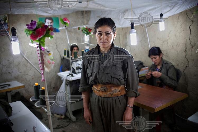 PKK member Zilan Mardin (35) from Mardin in Turkey, stands for a portrait at the sewing workshop. Labelled as terrorists by the Turkish, US and EU, it's in the Qandil Mountains near the border where the guerrillas of the PKK (Kurdistan Worker's Party) live and wage their 26 year war against Turkey that has claimed over 40,000 lives. According to a PKK spokesperson, the hospital was named after a patient who was killed in Turkish bombardment at a nearby hospital.