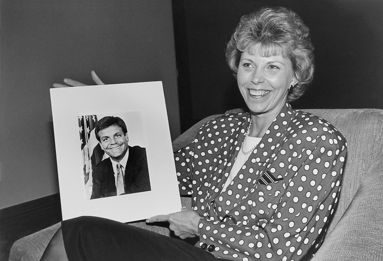 "Photo of Rep. Mike Synar, D-Okla., held by Sara Hill, a teacher in Fairfax, Virginia.  She won a date for $425.00 at a ""Bachelor Auction"" on May 13, 1991. (Photo by Laura Patterson/CQ Roll Call)"