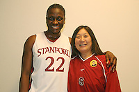 23 February 2006: Eziamaka Okafor with her locker room sponsor after Stanford's 100-69 win over the Washington Huskies at Maples Pavilion in Stanford, CA.