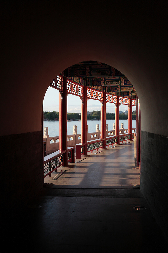 A corridor with traditional architecture under the White Dagoba pagoda along the Beihai lake. Beijing, 29 July 2012