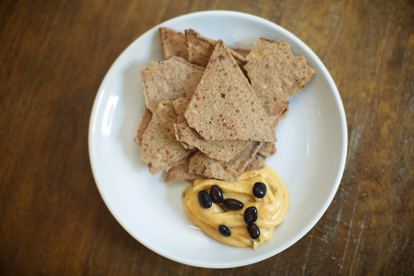 Brooklyn, NY - August 19, 2016:  Nachos with vegan cheese sauce and black beans by Vendy Awards Best Vegan nominee Vegan Bandwagon.<br /> <br /> CREDIT: Clay Williams for Gothamist.<br /> <br /> &copy; Clay Williams / claywilliamsphoto.com