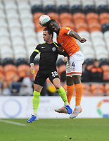 Blackpool's Rocky Bushiri battles for possession with Macclesfield Town's Ben Stephens<br /> <br /> Photographer Kevin Barnes/CameraSport<br /> <br /> The Carabao Cup First Round - Blackpool v Macclesfield Town - Tuesday 13th August 2019 - Bloomfield Road - Blackpool<br />  <br /> World Copyright © 2019 CameraSport. All rights reserved. 43 Linden Ave. Countesthorpe. Leicester. England. LE8 5PG - Tel: +44 (0) 116 277 4147 - admin@camerasport.com - www.camerasport.com