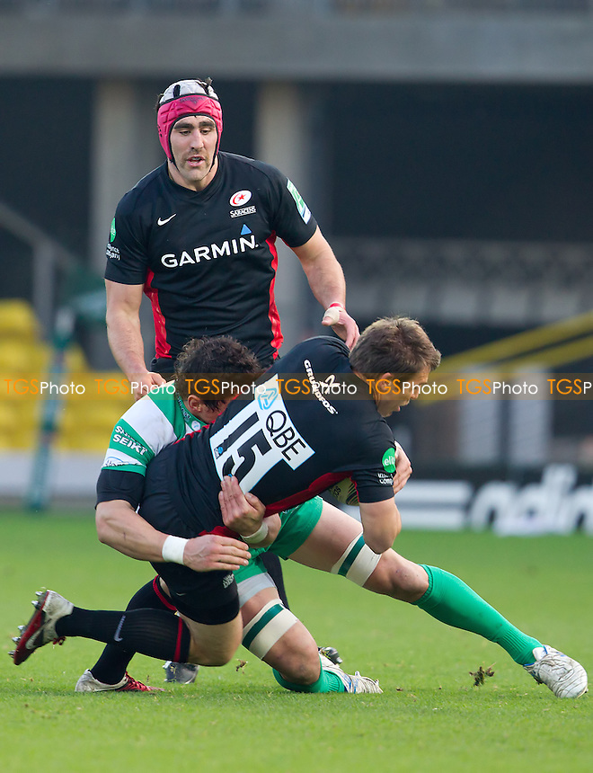 A strong defensive tackle halts Chris Wyles progress - Saracens RFC vs Benetton Treviso RFC - Heineken Cup Rugby Pool 5 at Vicarage Road Stadium, Watford FC - 13/11/11 - MANDATORY CREDIT: Ray Lawrence/TGSPHOTO - Self billing applies where appropriate - 0845 094 6026 - contact@tgsphoto.co.uk - NO UNPAID USE.