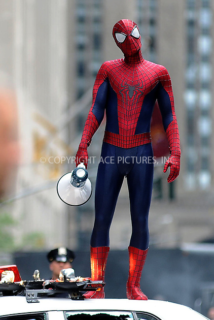 WWW.ACEPIXS.COM . . . . . .May 26, 2013...New York City....Andrew Garfield on the movie set of 'TheAmazing Spider-Man 2' on Park Avenue on May 26, 2013 in New York City. ....Please byline: Kristin Callahan....WWW.ACEPIXS.COM.. . . . . . ..Ace Pictures, Inc: ..tel: (212) 243 8787 or (646) 769 0430..e-mail: info@acepixs.com..web: http://www.acepixs.com .