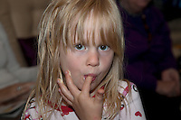 Polish girl age 4 licking sucking frosting from her fingers. Zawady Central Poland