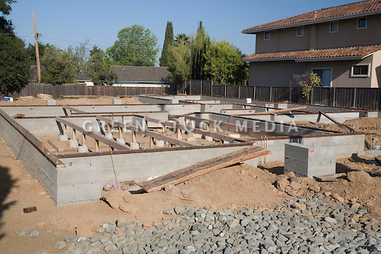 Residential concrete foundation of wood frame house under for Raised foundation types