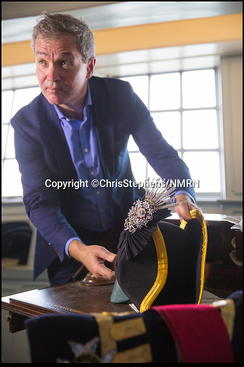 BNPS.co.uk (01202 558833)Pic: ChrisStephens/NMRN<br /> Author Martyn Downer with the recreated jewel and hat in Nelsons cabin.<br /> <br /> Brought back to life - An authors research into the audacious heist that stole Lord Nelson's most valuable jewel has led to the famous treasure being recreated in exact detail.<br /> <br /> The diamond Chelengk became one of the most iconic jewels in British history after he was presented it by a grateful Sultan Selim III of Turkey after his victory at the Battle of the Nile in 1798.<br /> <br /> Nelsons family sold the gem at auction in 1895, and it eventually found its way to the newly opened National Maritime Museum in Greenwich where it was a star exhibit. <br /> <br /> In 1951 the jewel was stolen in a daring raid by infamous cat-burglar George Chatham and lost forever.<br /> <br /> Now author Martyn Downer has commissioned an exact replica to coincide with the launch of his new book 'Nelson's Lost Jewel' - along with a new tricorn hat from Lock & Co, Nelsons hat makers in the heart of London who are still operating to this day.<br /> <br /> Martyn recently returned the diamond Chelengk, worth hundreds of thousands of pounds, to Nelson's day cabin on HMS Victory in Portsmouth where the National Museum of the Royal Navy will display it...under very tight security.