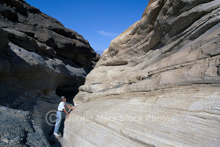 Death Valley National Park, California, CA, USA - Female Hiker hiking on Trail through Mosaic Canyon in Tucki Mountain (Model Released)